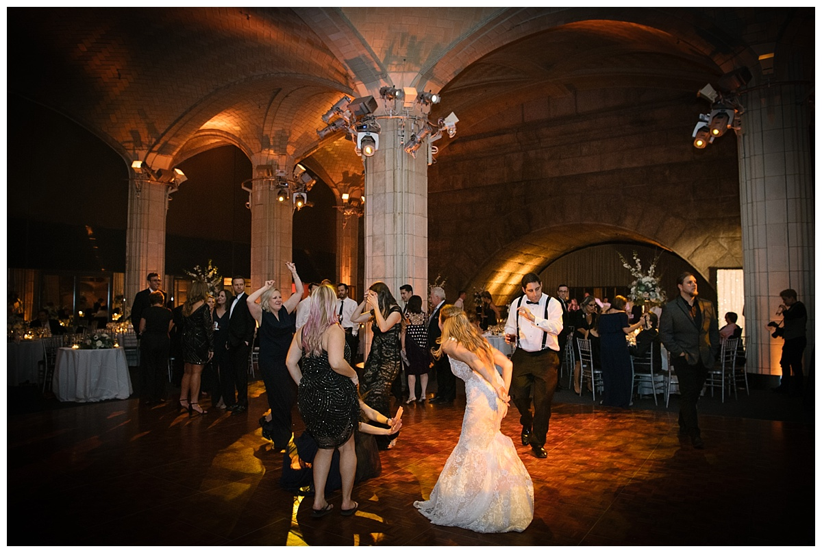 A newly wedded wife dancing with her wedding guests during a wedding reception at Guastavinos in New York City. Dress by Ines Di Santo.