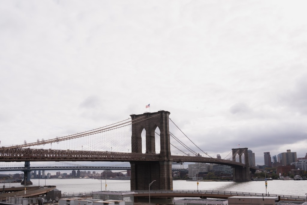 A view of a brooklyn bridge from a Mr. C Seaport Hotel before getting ready for a Cipriani Wedding