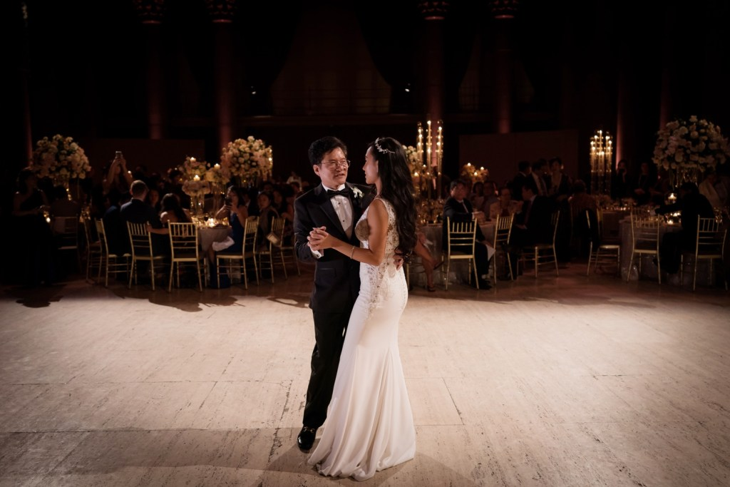 A newly wedded wife dancing with her father during a wedding reception at Cipriani Wall Street in New York City.