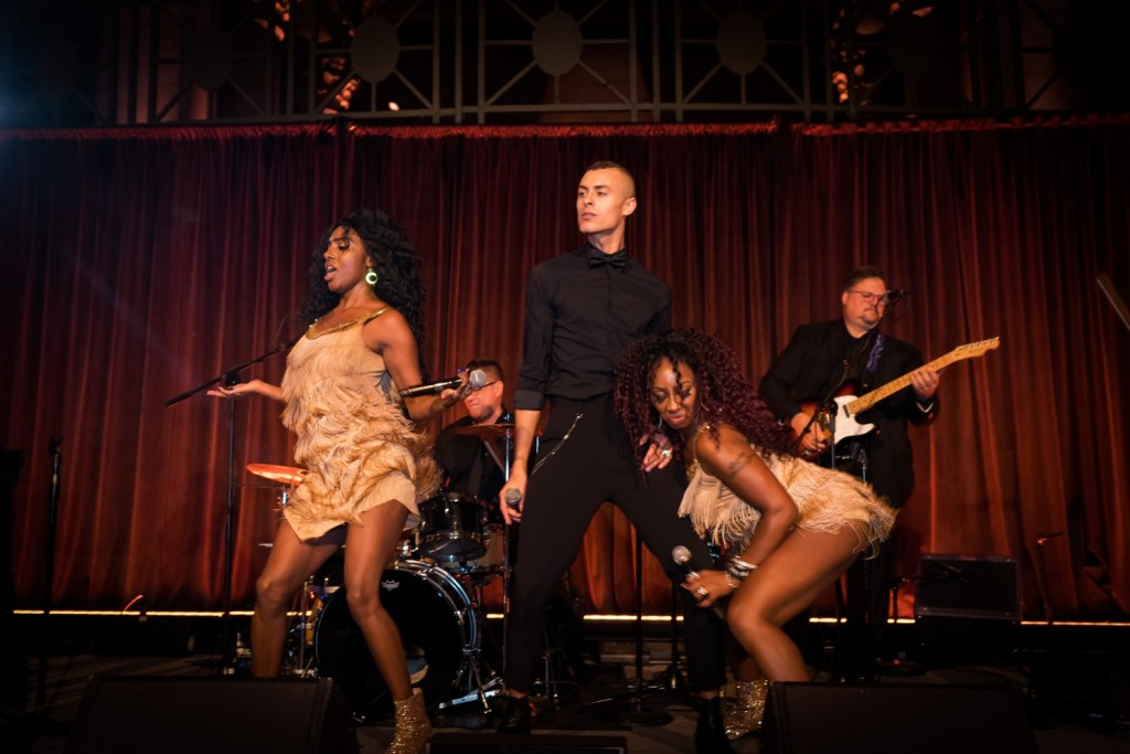 A live performance of Hank Lane Band during a wedding reception at Cipriani Wall Street in New York City.