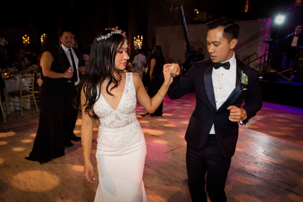A newly wedded couple dancing together during a wedding reception at Cipriani Wall Street in New York City.