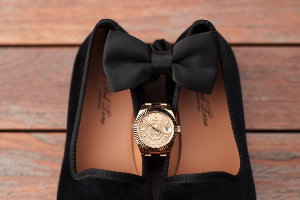 A rolex and a bowtie from a Mr. C Seaport Hotel on a wedding day at Cipriani Wall Street in New York City.
