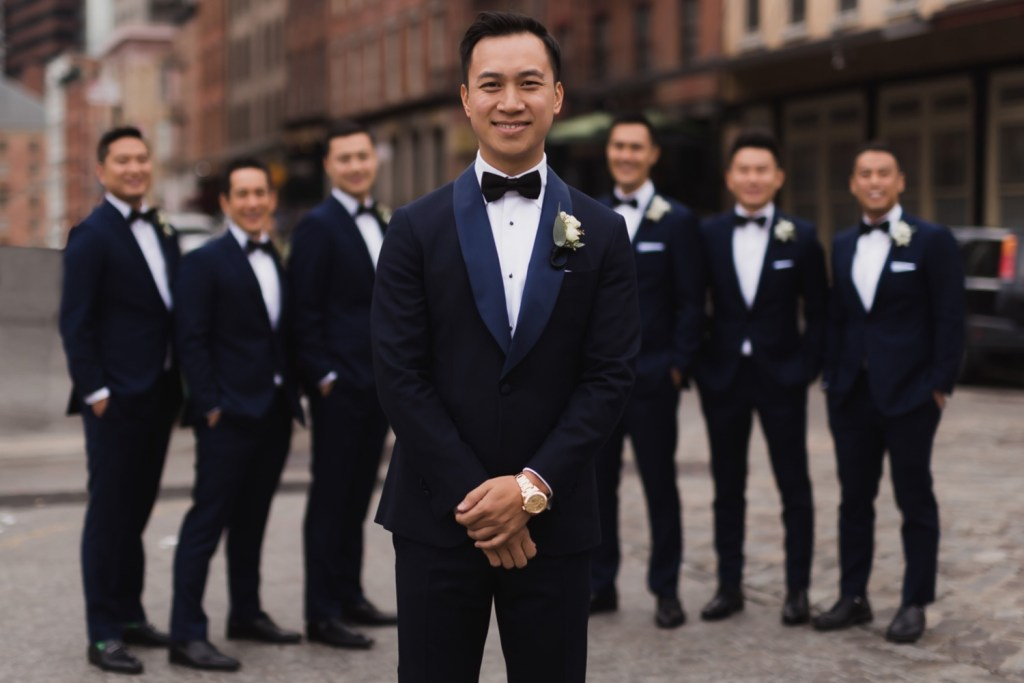 A portrait of a groom and his groomsmen near Mr. C Seaport on a wedding day at Cipriani Wall Street in New York City.