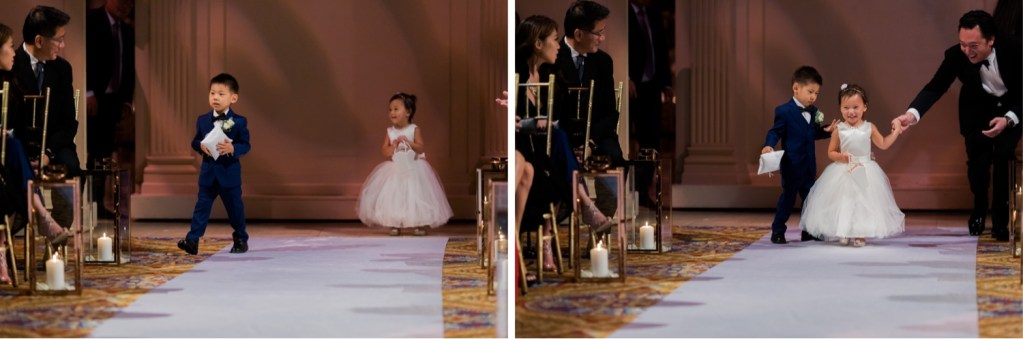A wedding bearer and a flower girl walking in an aisle during a wedding ceremony at Cipriani Wall Street in New York City.