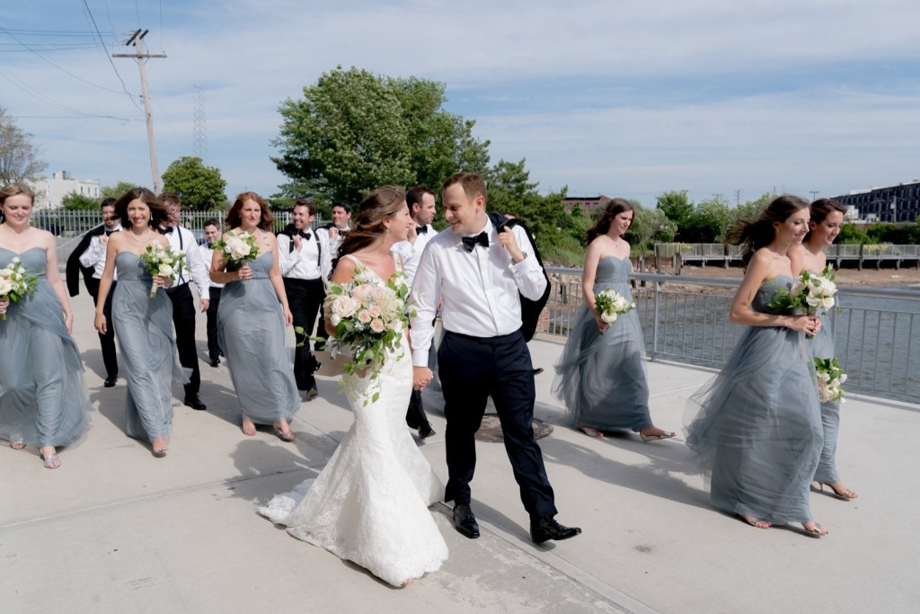 A portrait session of a bride, a groom, and their wedding parties near Liberty Warehouse, Brooklyn New York.
