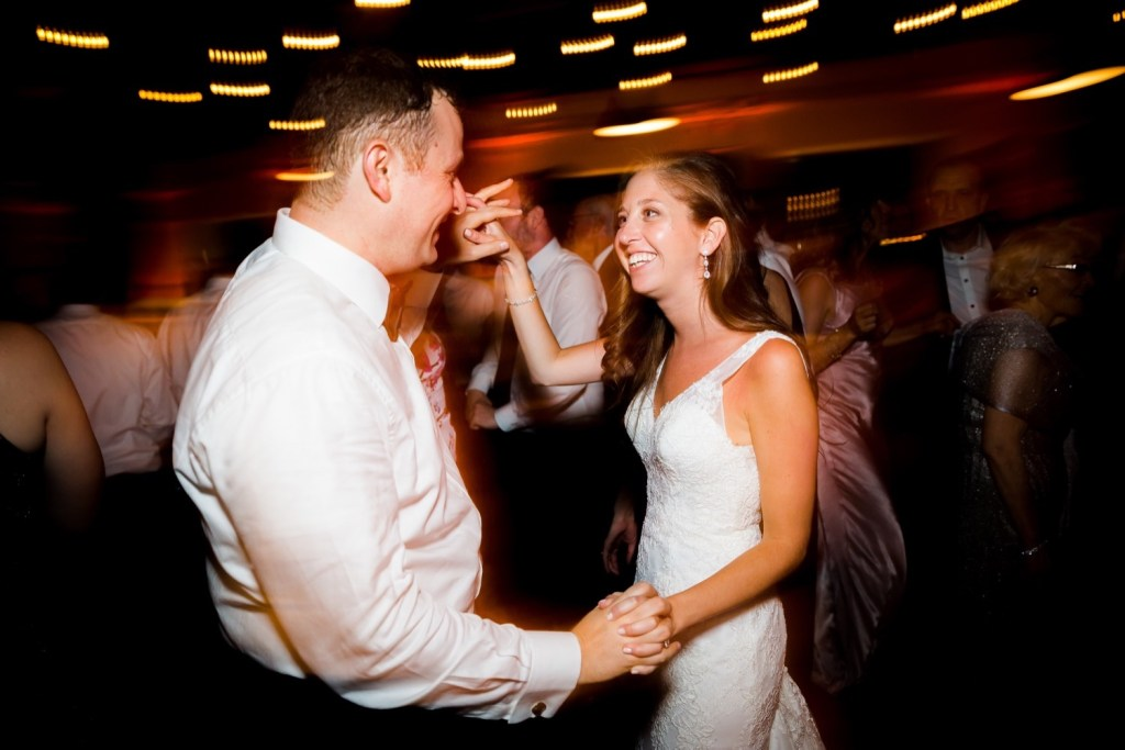 A newly wedded couple dancing together during a wedding reception at Liberty Warehouse, Brooklyn New York.