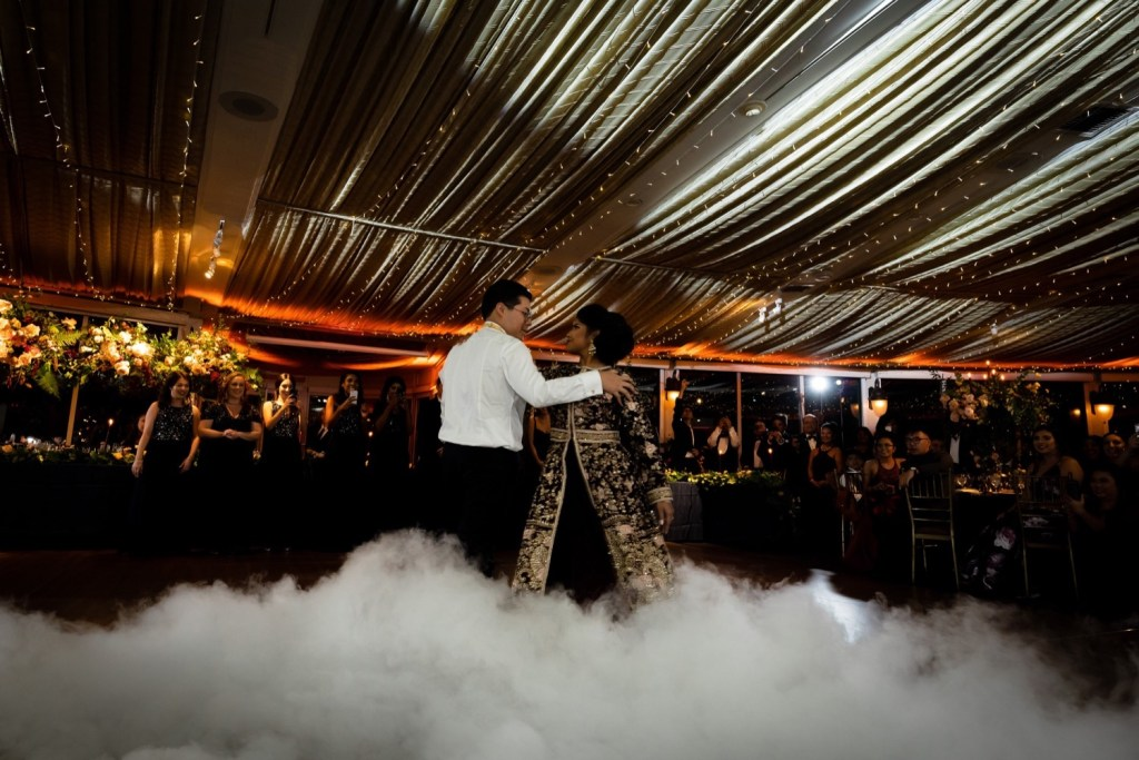 A newly wedded couple's first dance during a wedding reception at the Tappan Hill Mansion.
