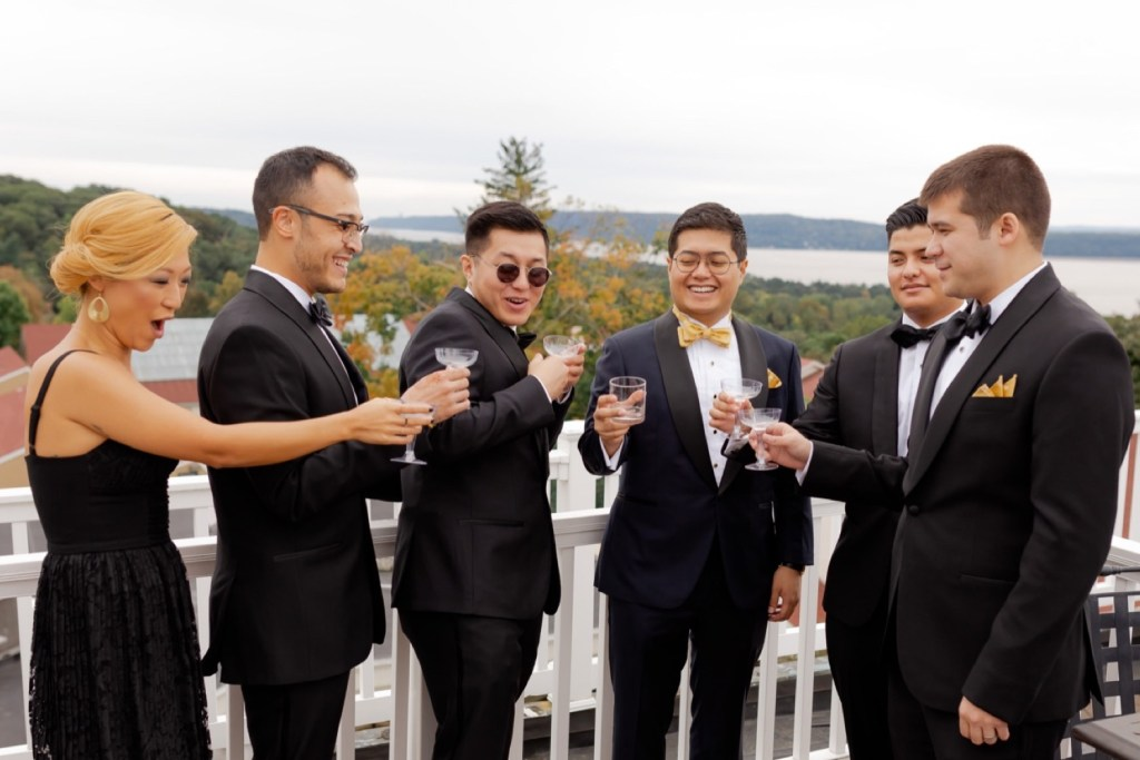 A groom and his wedding party celebrating his wedding day at the Tappan Hill Mansion.
