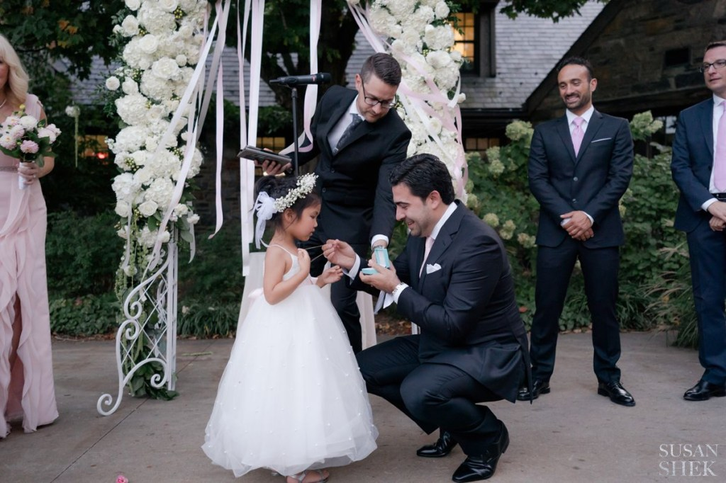 flower girl receiving gift at blue hill stone barns