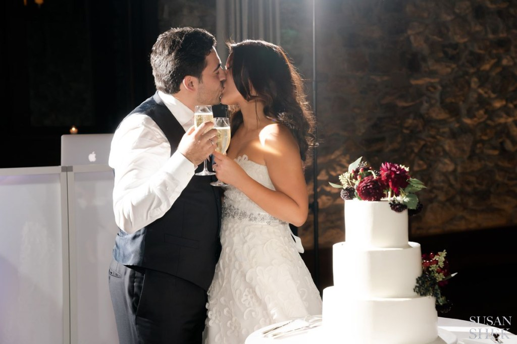 cake cutting kiss at blue hill stone barns