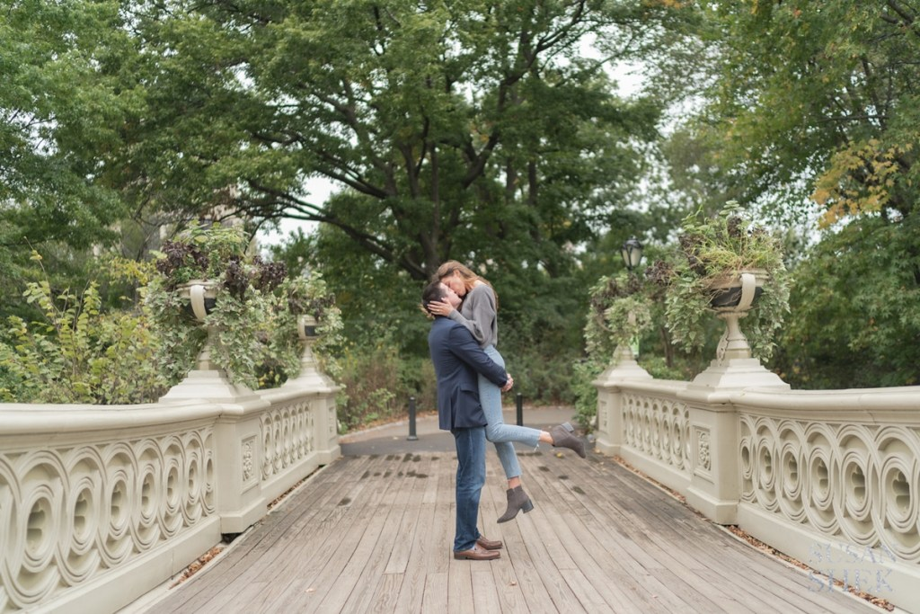bow bridge at central park for a photo shoot with a gorgeous couple