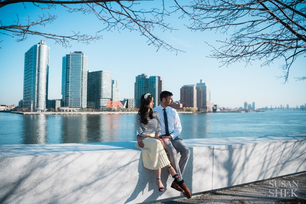couple sitting on the edge of roosevelt island