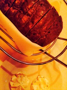 Housemade bread with two kinds of herbed butter.