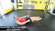 trx hamstring curls on hands with scissors