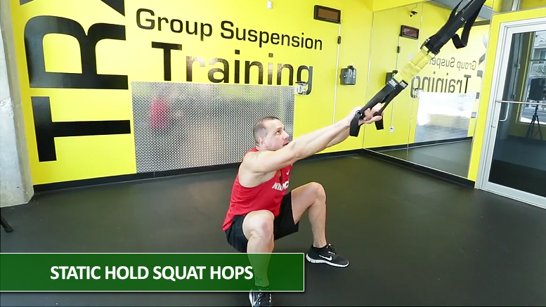 Static hold squat hops - TRX leg exercises