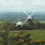 A painting of the Sussex windmills Jack and Jill on the South Downs