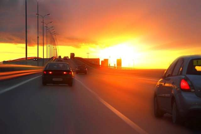 Cars on motorway at sunset