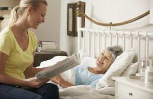 Elderly woman being cared for