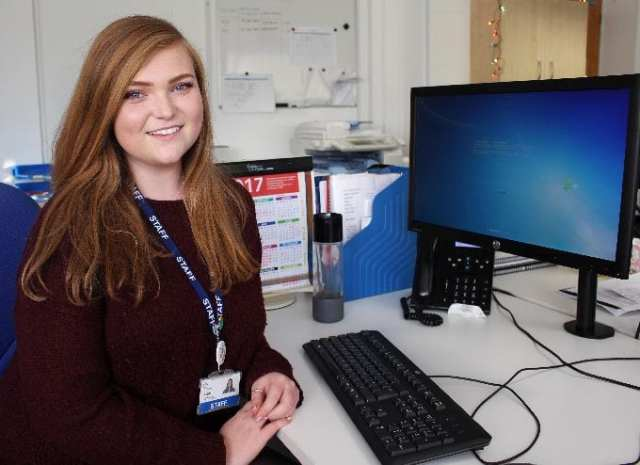 Emma at work as a communications apprentice