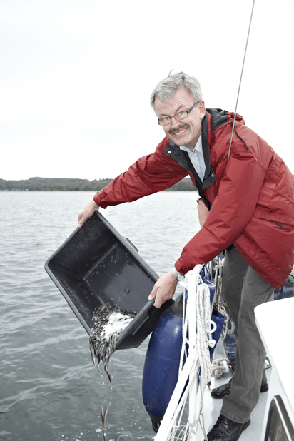 The Minister for Food, Agriculture and Fisheries, Mr Henrik Høegh restocking Juelsminde Fjord