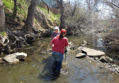 Volunteers including OTT Hydromet's John Malinowski cleanup waste from waterways in Loveland, CO during the annual city-sponsored cleanup