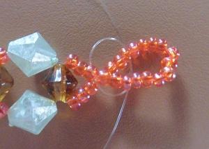 Armband met kralensluiting andere sluiting knoop aan de achterkant