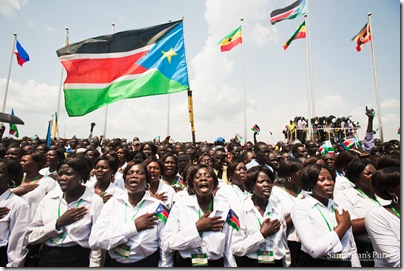 """South Sudanese choirs sang the national athem at the Independence Day ceremony in 2011.  Part of the lyrics include, """"Oh God, we praise and glorify You for Your grace on South Sudan ..."""""""