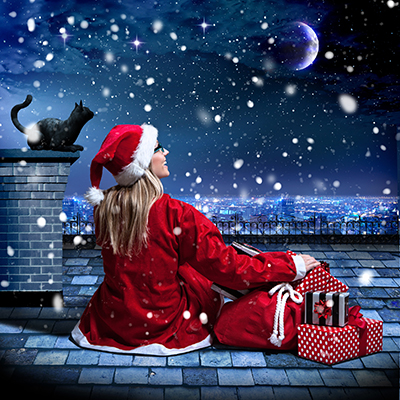 Santa sitting on a rooftop