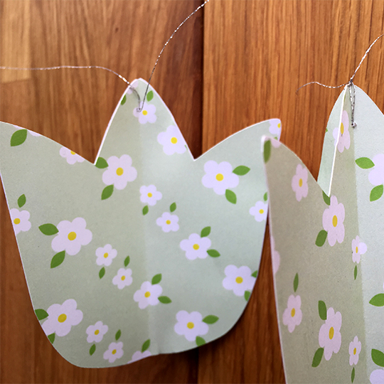 sewn together tulips for a paper flower mobile
