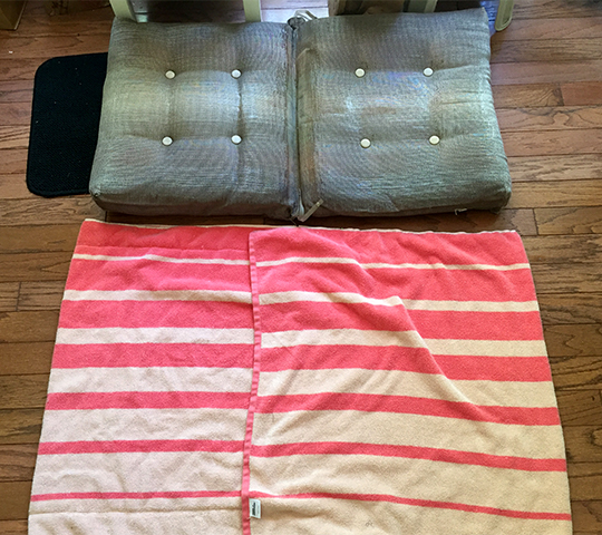 Envelope style cover made from towels gives new life to old outdoor cushions