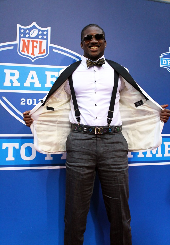 Cordarrelle Patterson shows off his suspenders during the red carpet portion of the NFL draft of Football, outside Radion City Music Hall in New York City