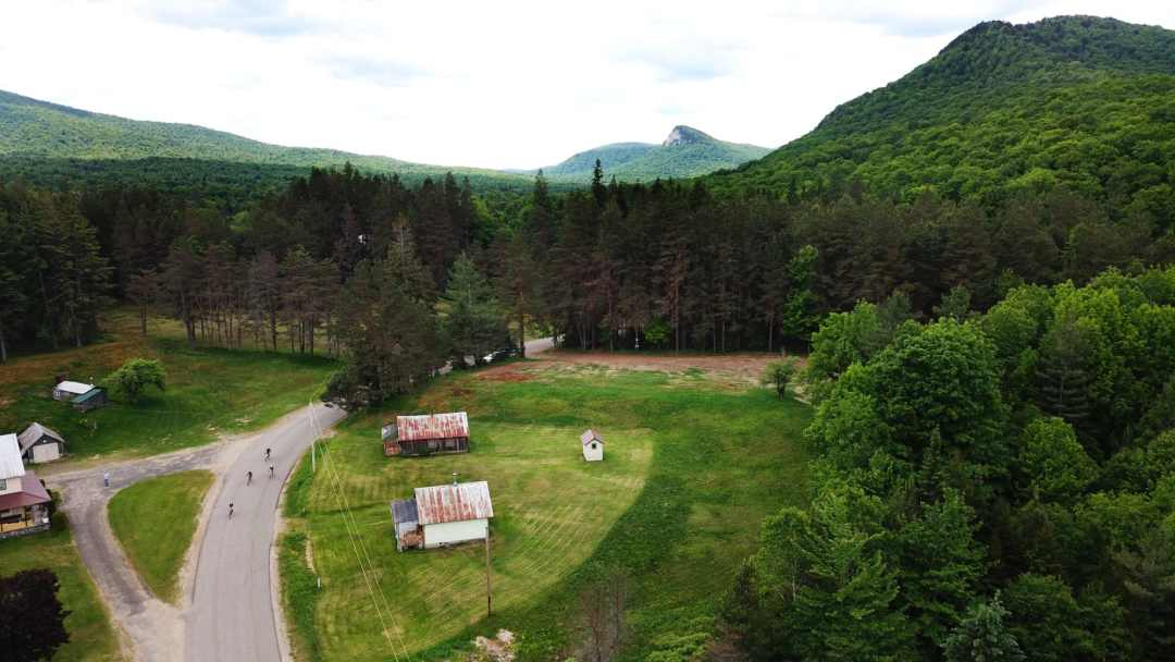 Green fields, pastureland and old barns surround two bikers during the Black Fly Challenge in Inlet, New York