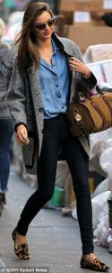 Another one of our V-Secret Angels, Miranda Kerr, sporting denim with black pants, a nice winter coat and comfortable flats.