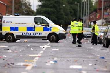 A police van is parked across the area of Claremont Road, Moss Side, Manchester, where several people have been injured after a shooting., Image: 382174913, License: Rights-managed, Restrictions: , Model Release: no, Credit line: Profimedia, Press Association