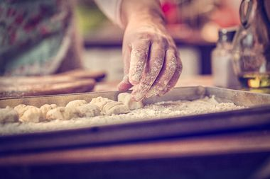 Preparing fresh homemade gnocchi pasta with potato dough.