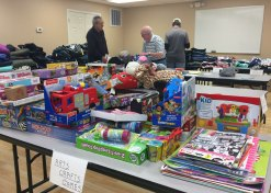 Volunteers sort toys donated to Santa Shop.