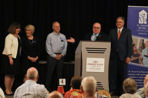 Adam Hall (at podium) accepting the Corporate Partner of the Year Award on behalf of Fifth Third Bank. Back row, from left, LouAnn Atlas of Fifth Third Bank, Donna Young, Ed Wnorowski and Doug Proffitt.