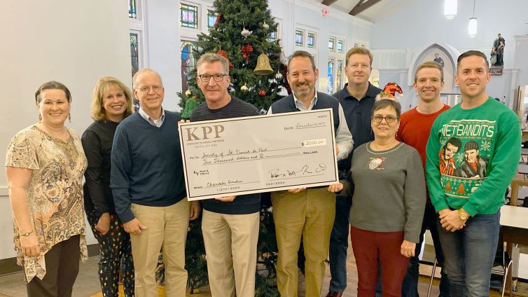 On December 11, Kentucky Planning Partners brought KFC for dinner at the Open Hand Kitchen and presented St. Vincent de Paul Louisville with a $2,000 donation.