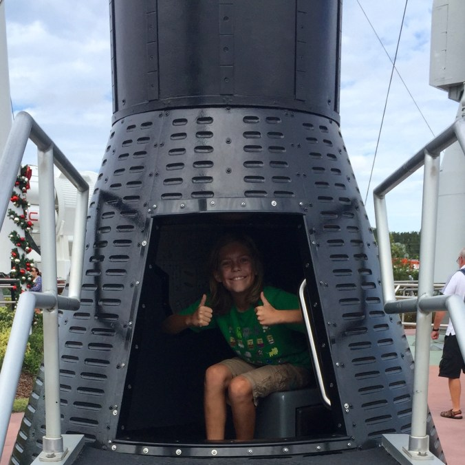 Soren in a Mercury capsule. Tiny!