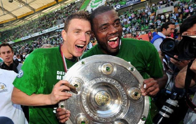 WOLFSBURG, GERMANY - MAY 23: Edin Dzeko and Grafite of Wolfsburg celebrate the German championship with the trophy after their Bundesliga match against SV Werder Bremen on May 23, 2009 in Wolfsburg, Germany. Wolfsburg won its first German championship ever. (Photo by Stuart Franklin/Bongarts/Getty Images)