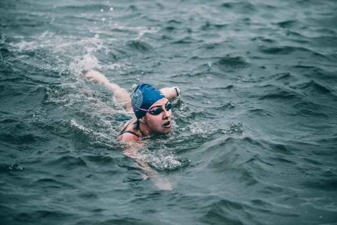 person swimming in ocean
