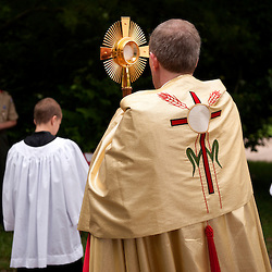 2 JUNE 2013 -- IMPERIAL, Mo. -- Monsignor Timothy Cronin, pastor at St. Joseph Catholic Church in Imperial, Mo., participates in a Feast of Corpus Christi procession in the neighborhood adjacent to the church Sunday, June 2, 2013. The procession was the first since the parish moved to its' current location in Imperial in 1998. Photo by Sid Hastings.