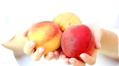 peaches in hands