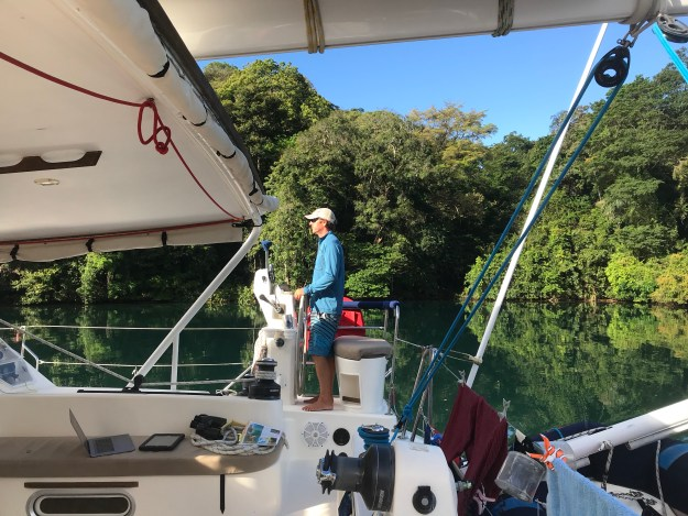 Matt at the helm with 50' trees on Rio Chagres