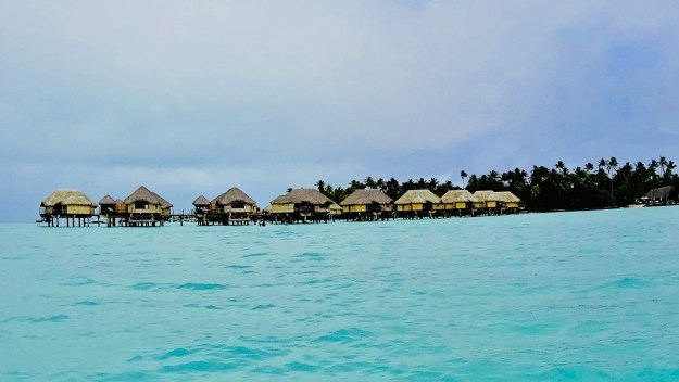 Tahaa Hotel Complete with Thatched Huts Over the Water