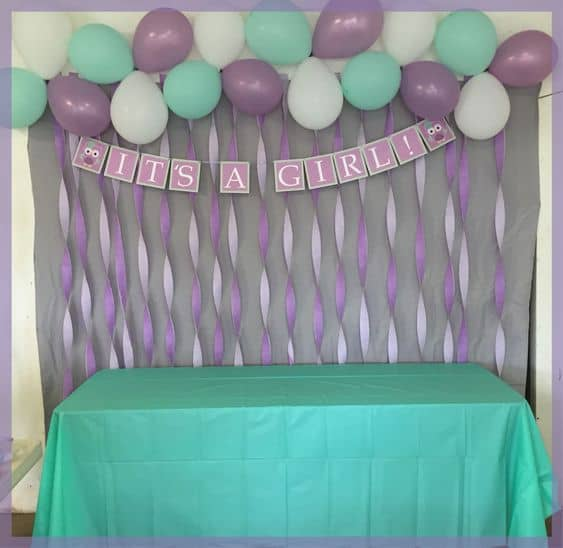 Easy Backdrop for baby shower with items from the dollar store and a free printable banner!