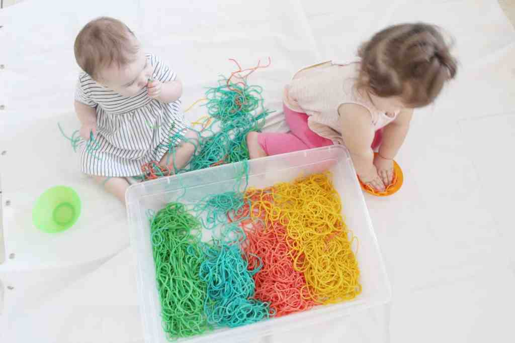 Sensory activities for baby and toddler- rainbow spaghetti!