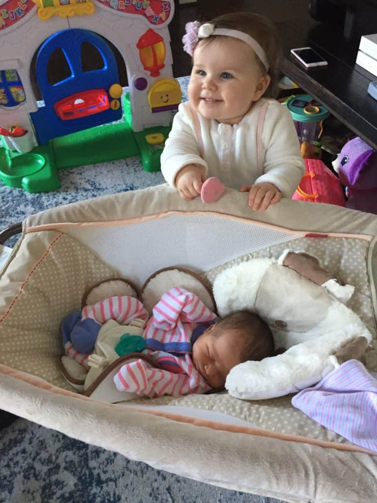 """Why we introduced our toddler to our newborn in a """"neutral"""" way."""