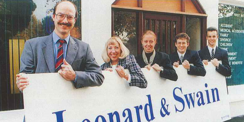 Sign of growth - Graeme Swain & staff outside their new office