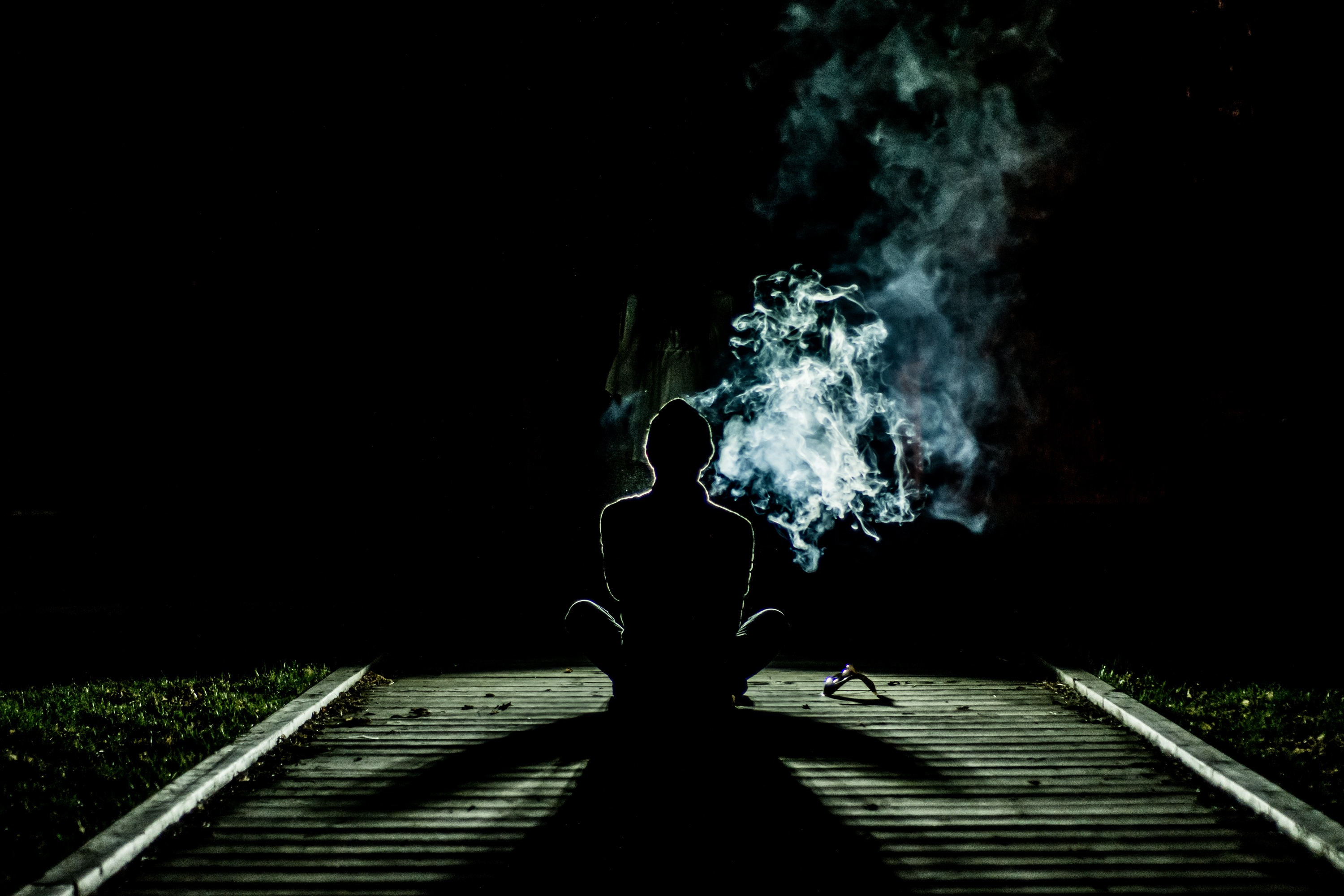 Man sits and meditates in the night